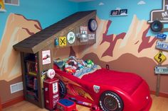 Radiator Springs, I have a three year old who is infatuated with Lightning McQueen and the world of Cars, so when we moved to a new home, I took the opportunity to create a little slice of Radiator Springs for him to live in., I designed and painted the mural, using Disneys Art of Animation hotel in Orlando for inspiration. The garage was framed by using two small shed trusses and a bookcase for the wall. The garage was then covered with rough 1x4s, painted, and shingled.     , Boys Rooms…