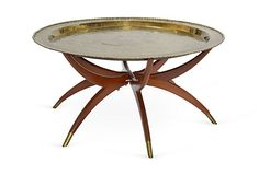 Oriental-style brass-top table on walnut base with six legs, 1960s. OKL price: $989.