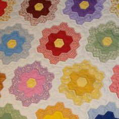 Vintage 1930's Grandmother's Flower Garden Quilt....my all time favorite.  just makes me happy to look at it.  So perky!