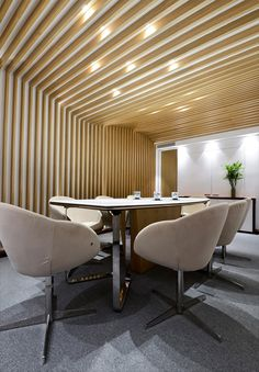 wooden rafters, custom made, flowing wooden ceiling, conference room, custom made table, white crystalized glass table, high gloss SS, integrated lighting