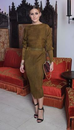 Olivia Palermo in a bronze midi dress with burgundy bag
