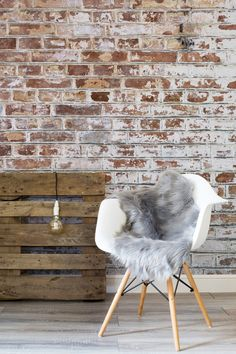 In love with exposed brick walls? Recreate the look with minimal effort using this brick effect wallpaper design. The white paint adds another layer of texture and works beautifully with white furniture.