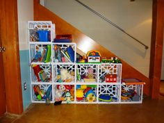 DIY kid storage for under fifty dollars in under 30 minutes made out of file crates and zip ties.