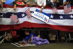 Oct. 27, 2012. A young boy looks out from under the barrier at the edge of the stage as Republican presidential nominee Mitt Romney speaks at a campaign rally in Pensacola, Fla.    Read more: http://lightbox.time.com/2012/11/02/pictures-of-the-week-october-26-november-2/#ixzz2BKdx5x9t