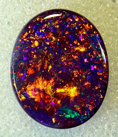 "Black Opal is Australia's national gemstone, and black opal is the rarest and most valuable of its kind, at times selling at prices that rival the best diamonds.  The stone must have a rich, black background, but base colors come in all shades of gray, which is why opinions vary on what is a ""true"" black opal.  Found in the Lightning Ridge area in northwestern New South Wales, black opals are natural, solid stones that absorb scattered white light, giving it brilliant spectral colors."