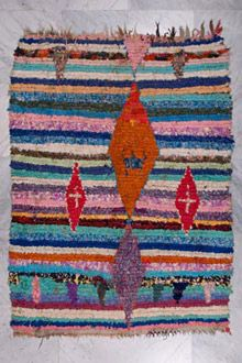 Can't help but be inspired by the hand-drawn nature of these vintage boucherouite rag rugs.