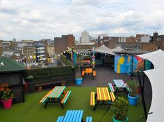 THE QUEEN OF HOXTON London, United Kingdom  London isn't known for particularly long summers, so when nice weather arrives, it's best to take advantage. At this East London roof bar, cheerfully colored tables and faux grass play up the warm-weather vibe. You can also head here for alfresco cinema courtesy of the Rooftop Film Club, which this summer will be showing '80s favorites like Ghostbusters and Flashdance.To drink: