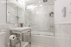 Upper East Side bath with luxe marble square tiles and old-fashioned marble sink with modern chrome lines.