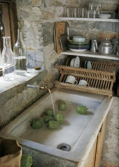=Steel water pipe with brass tap as a wall mounted faucet for an antique limestone farm sink=