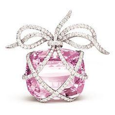 Pink diamond wrapped with smaller white diamonds....simply gorgeous!