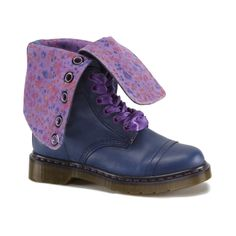 Womens Dr. Martens Triumph Boot in NavyPurple at Journeys.com.The Triumph boot from Dr. Martens features a leather upper which folds down to reveal a plaid print lining. Features include a12-eye ribbon lace up closure and welted slip resistant sole. ORDER IN YOUR NORMAL U.S. SIZES. Available only online at Journeys.com!