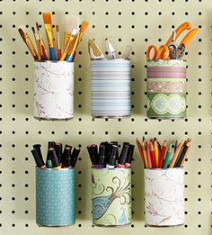 pegboard and paper-covered tin cans for craft room storage! Punch a hole in the back of can to hang