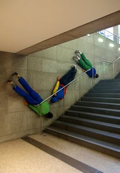 """Fake bodies as street art. Link doesn't say the artist but it could be by Mark Jenkins who specializes in street installations, some of which can be described as """"prank"""" installations."""