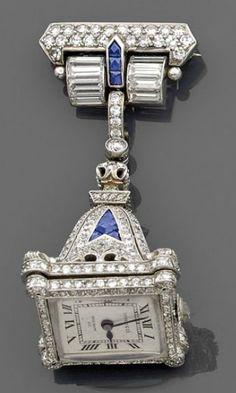 An saphhire, diamond and platinum lapel watch, by Patek Philippe and Tiffany, circa 1920.