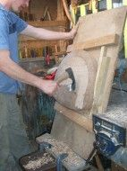 Hollowing out a chair seat with a short handled adze