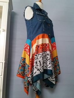 All shipping overages over $1 are refunded to my customers. All Deep Waters Couture items are made from pre-loved garments. Some fabrics used to redesign the base garments are new, but mostly they are re-purposed fabrics. This denim vest has been reborn into a gorgeous gypsy