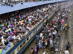 People overcrowd a train in an attempt to travel to their villages ahead of the Eid Al-Adha celebrations at the Airport Railway Station in Dhaka, Bangladesh. Millions of Muslims travel back to their villages to celebrate Eid Al-Adha.  Abir Abdullah, European Pressphoto Agency