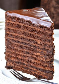 24 Layer Chocolate Cake: 12 layers of smooth chocolate filling and 12 layers of rich chocolate cake, topped off with a layer of silky chocolate ganache! Ingredients For Chocolate Cake, Chocolate Mousse Cake Filling, Chocolate Cake From Scratch, Decadent Chocolate Cake, Layer Cake Recipes, Homemade Chocolate, Chocolate Desserts, Dessert Recipes, Bonbon