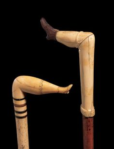 CANE WITH FEMALE LEG HANDLE & CANE WITH FEMALE LEG AND DARK BOOT HANDLE/ Artists unidentified, Probably eastern United States, c. 1860, Whale ivory and whale skeletal bone with horn, American Folk Art Museum, photo by John Bigelow.