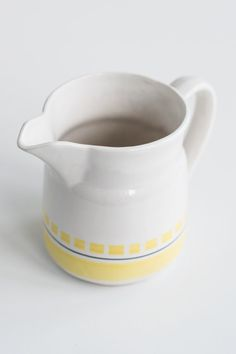 Beautiful vintage white jug with yellow decor.  Measures: height - 6 (15 cm) diameter - about 4 1/3 (11 cm)  Very good vintage condition.  *