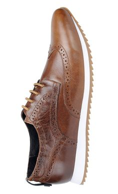 Leather lace-up wingtip casual chic oxford shoe with tonal lace up closure and a sporty jigsaw lightweight rubber sole.