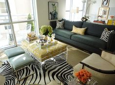 A living space bursting with color and pattern but anchored by neutrals.  Home of Hallie Henley.