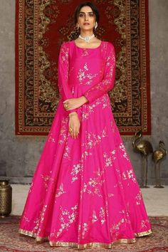 Look elegant when wearing this ultra pink taffeta silk anarkali suit which will make all the goddesses of love and beauty to write you for your advice. This U neck and full sleeve party wear suit designed using foil print work. Paired with santoon/ lycra churidar in ultra pink color with ultra pink net dupatta. Churidar and dupatta is plain. #anarkalisuit #usa #Indianwear #Indiandresses #andaazfashion Churidar, Anarkali, Salwar Kameez, Indian Ladies Dress, Indian Gowns, Party Wear Gowns Online, Casual Gowns, Ethnic Gown, Net Gowns