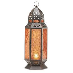 2 Large Glass Tall Moroccan Lanterns Candle Holder [Misc.]:... ($240) ❤ liked on Polyvore featuring home, home decor, candles & candleholders, glass candlestick holders, moroccan lanterns, glass lanterns, moroccan candle holder and glass home decor
