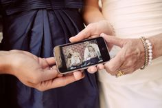 Her sister & nephew were unable to attend due to serious illness - the bride, mother of the bride & her other sister still managed to take a photo with them. It's a great way to incorporate a lost loved one into your wedding day as well.