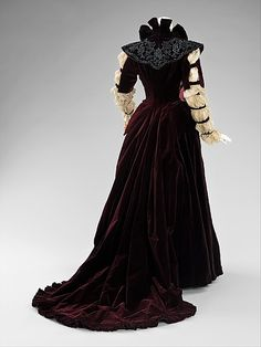 1890  This dress is in keeping with the interest in historical revivals popular in the 19th century. The long puffed sleeves refer to both Elizabethan and early 19th-century styles. The one-piece construction indicates it was probably intended for formal reception at home.
