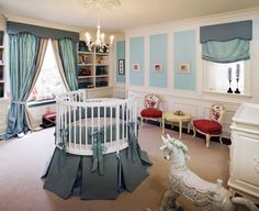 Nursery- I LOVE the round crib in the middle of the room