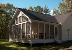Screened porch exterior with arched window.