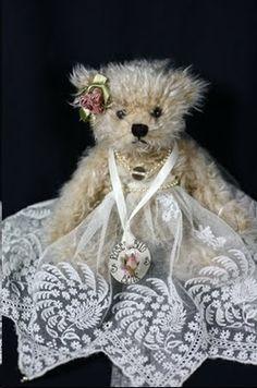 Rosebud Bear in her antique Irish Limerick Lace dress, posted via needleprint.blogspot.com