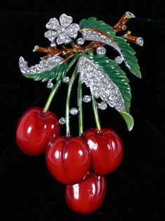 """Trifari cherries pin/brooch. Deep red and green enamel with rhinestones. 3\"""" x 1.5\"""".  Excellent condition."""
