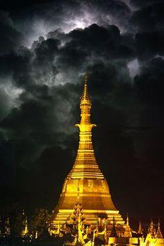 Lightning is seen over the glowing Sule pagoda in Rangoon, Burma.#Myanmar