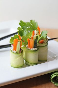 Raw Zucchini Sushi Rolls  1/2 cup cashews, soaked overnight  1 Tablespoon rice vinegar  3 - 4 zucchini (each yields 6 - 8 slices)  2 carrots, sliced into matchsticks  1 cucumber, seeds removed and sliced into matchsticks  4 medium radishes, sliced  1 avocado, peeled and sliced  1 small bunch cilantro