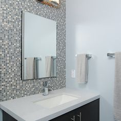 small sink and tile wall modern bathroom by Kerrie L. Kelly
