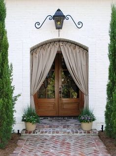 sunbrella fabric    dbl doors...outdoor lighting above door frame