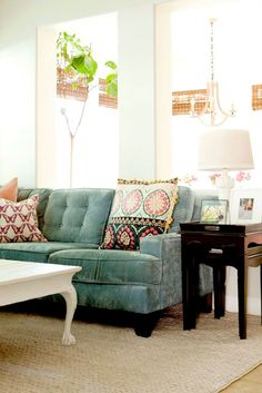 Slate Green Velvet Sofa - love the Moroccan style pillows with the modern/classic couch