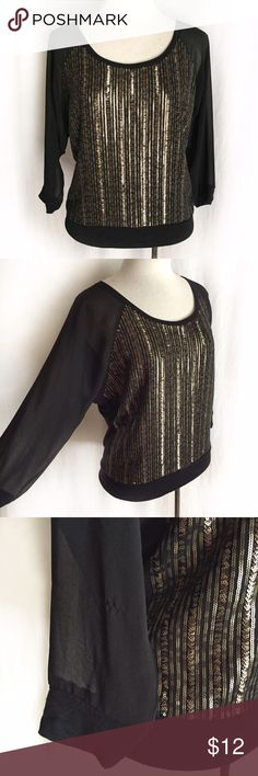 """Express Black Dolman Sequin Top Loose fitted black top with metallic sequin front and solid back. Sheer three-quarter sleeves. Cuffs, hem and back are a soft, stretchy rayon. 100% polyester (front, sleeves); 100% rayon (trim). Hand wash. Size Small. Bust: 19.5"""" flat across. Waist: 17"""" flat across. Length: 23"""". *Right sleeve has a pull/snag on the forearm; otherwise EUC. Thanks for looking! Express Tops"""