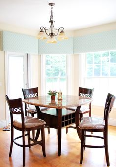 A serene blue valance is a great backdrop for a light filled dining room.     nationaldrapery.com http://nationaldrapery.com/blog @draperycanada