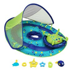 Introduce your baby to the water with the SwimWays Baby Spring Float Activity Center with Canopy baby float! This brightly colored inflatable baby floaty has fabric covered inflation and a soft mesh seat for durability and comfort. A lower center of gravity, safety valves and separate air chambers ensure security and stability. The rotating octopus character provides a focus for play with each octopus tentacle holding a toy that baby can touch and activate: 1 fish teether, 1 soft star, 1 set…