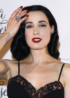 The Statement Ring - worn by Dita Von Teese - Got to love the classic diamond cluster ring.