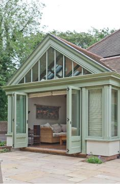 Conservatory with folding doors in Hampshire.