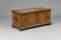 PENNSYLVANIA PAINTED AND DECORATED DOWER CHEST. Sold: $2,610 ($2,250) The top with two panels and the front with two panels of potted tulips and flowers framed by column and scroll motifs, the corners with hearts wrapping around to the sides, each side with two column motifs. Height 21 inches, top 46 x 21 inches.