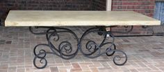 This would look great with a timber top as well. Dress up your outdoor dining with an heirloom. This wrought iron table base $2100, sandstone look top (GRC) $850, total $3000