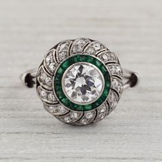 Diamond and Emerald Ring. OMG - if I ever replaced my engagement ring, it would be with this!!!!!
