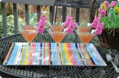The Bunny-tini  3 1/2 cups Simply Raspberry Lemonade  3/4 cup coconut rum (Malibu)  5/8 cup amaretto  Simply mix, pour and embellish with a bunny Peep (cut a slit in the bottom of the Peep and the marshmallow inside will help stick it to your glass.)
