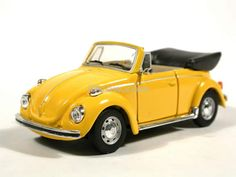 VW Beetle convertible.  We had a bright yellow one just like this growing up -- it's how I learned to drive a stick!