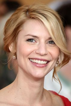 Claire Danes Lookbook: Claire Danes wearing Loose Bun (12 of 18). Claire Danes wore her flaxen locks in a romantic loose bun with face framing curled bangs.